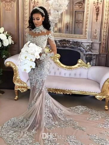 Luxe 2020 Sirène Robes de mariée Robes de mariée sexy Sheer manches longues col montant bling dentelle perlée Appliqued arabe Vestidos De Novia Dubaï