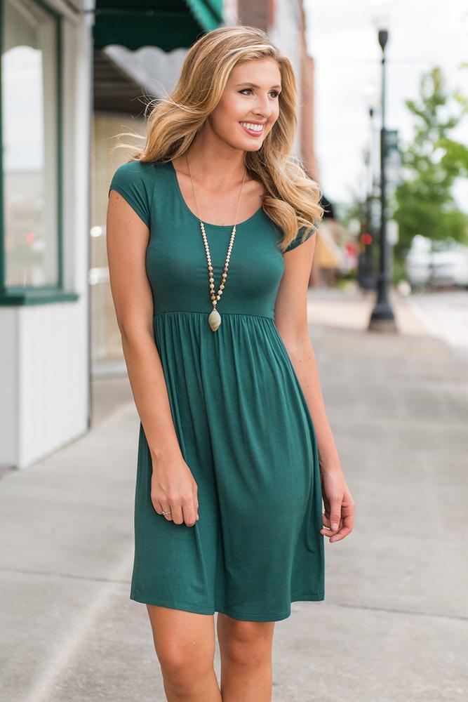 Yaz yeni en çok satan Avrupa ve Amerikan moda kadın, kısa kollu bel, yuvarlak boyun, düzensiz, düz renk, büyük sarkaç etek