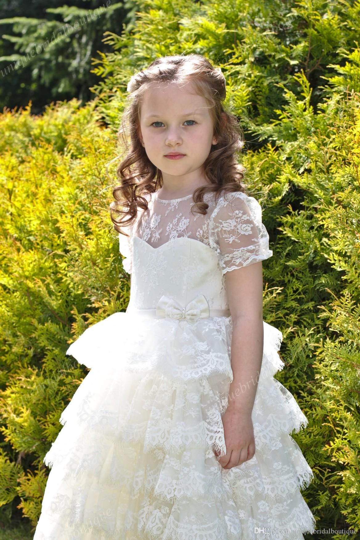 Cupcake Flower Girls Dresses 2017 with Short Sleeves and Ruffles Skirt Ball Gown Tea Length Fully Lace First Communion Dress for Little Girl