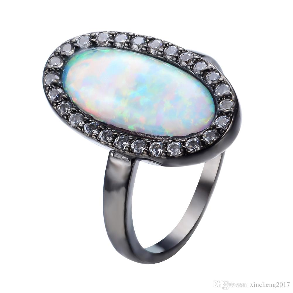 a808fbb630d48 JUNXIN Hot New White Zircon &Rainbow Fire Opal Ring Shining Black Gold  Filled Wedding Party Rings For Women Birthday Gift