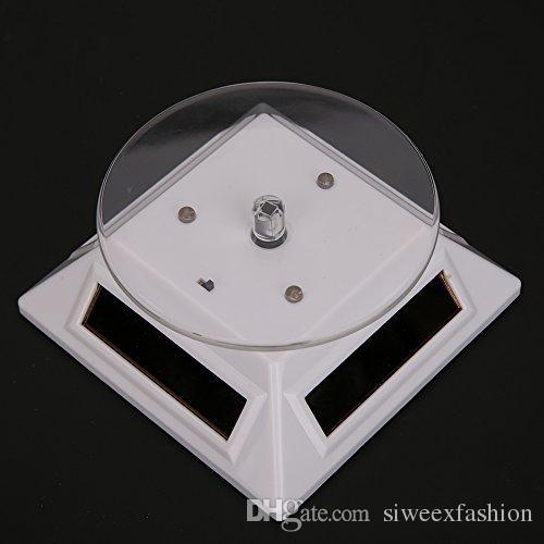 Nouvelle 360 degrés Turntable Rotation Bijoux Montre Bague Affichage Vitrine Solaire avec 3 Lumières LED Colorées