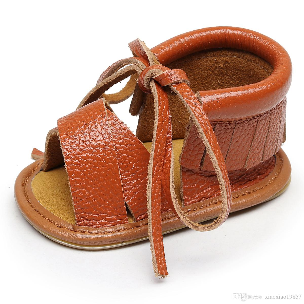 511f1af1c25517 New Style Genuine Leather Hollow Lace Up Baby Sandals Hard Sole Kids Shoes  Fashion Fringe Summer Baby Sandals for Girls And Boys Baby Sandals Girls ...