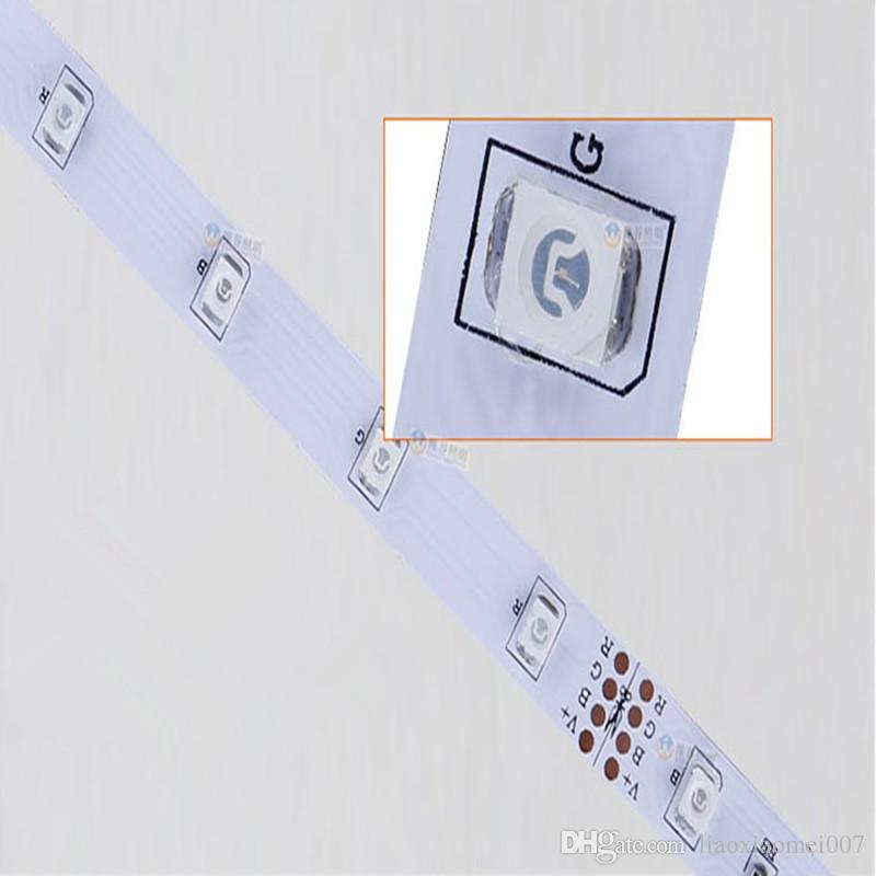 Venta caliente RGB / Blanco / blanco cálido / Bule / Amarillo / Rojo / Verde 3528 300leds no impermeable tira de luz LED 5 m / rollo + 24 teclas IR remoto