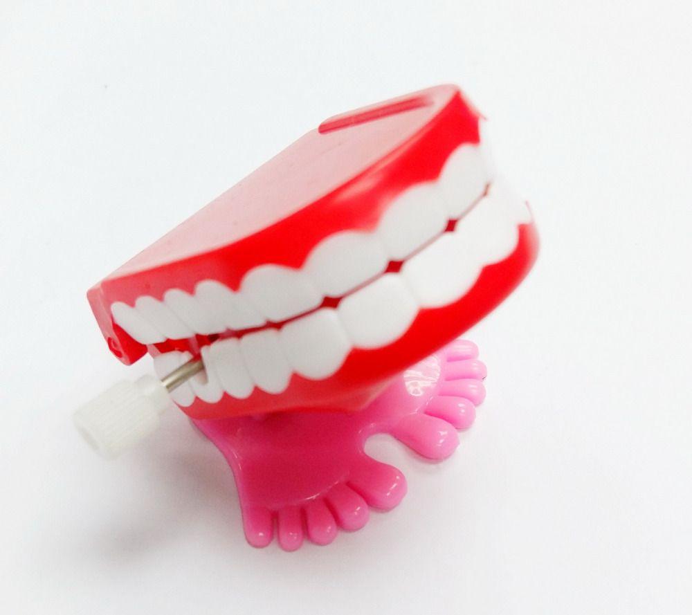 NEW Jump Zähne kreatives Spielzeug Kinder Uhrwerk lustigen Sprung Mund Aufziehspielzeuge