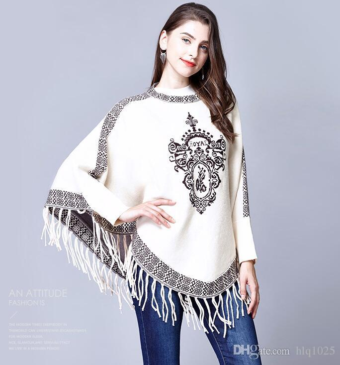 Europe style women's casual sweater female cloak batwing sleeve knit sweater slash design o-neck long sleeve blouse tops one size