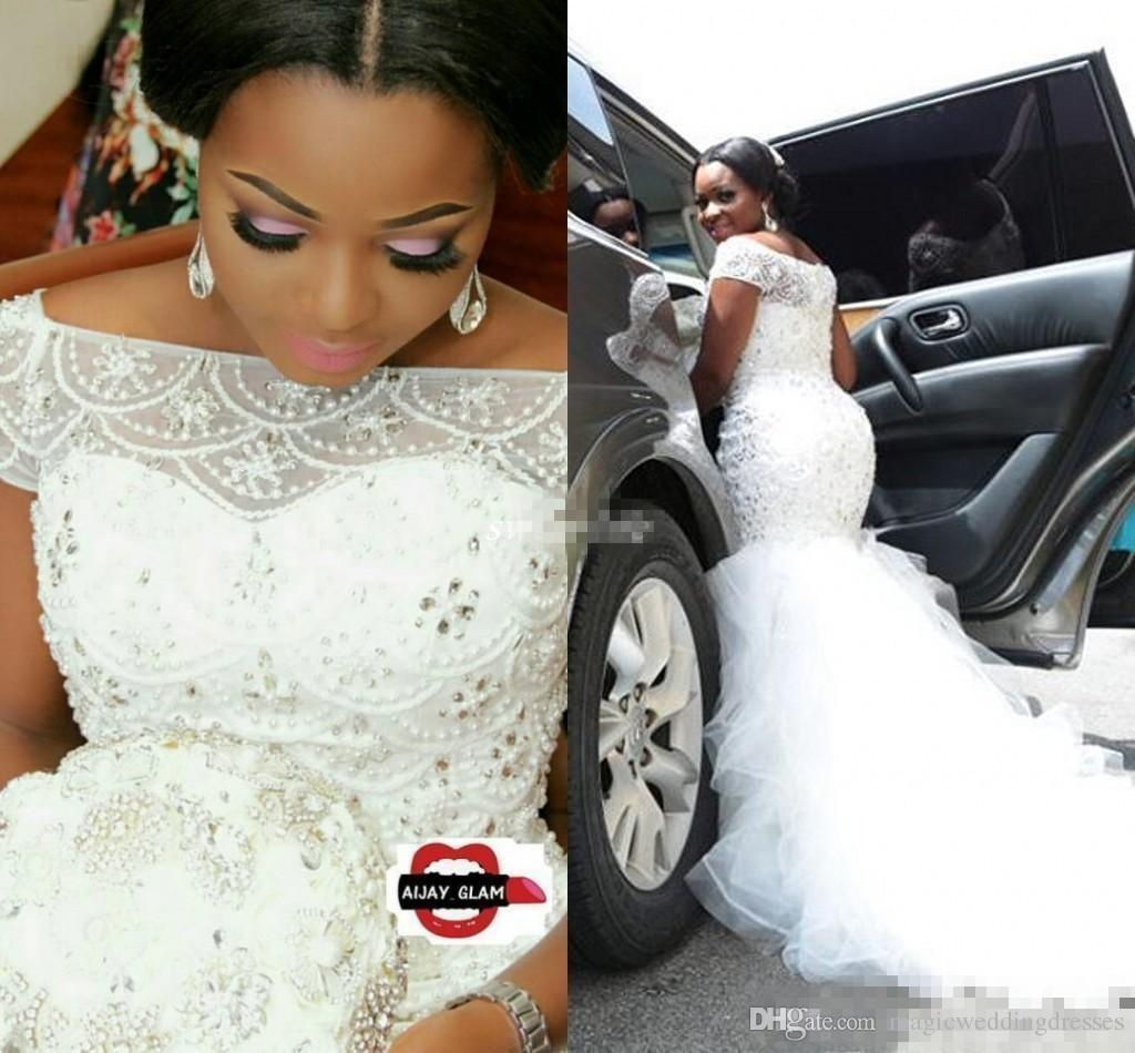 Plus Size Arabic Nigerian Wedding Dresses 2017 Mermaid Luxury Beading Pearls Sheer Bateau Neck Short Sleeves Chapel Train Tulle Bridal Gowns