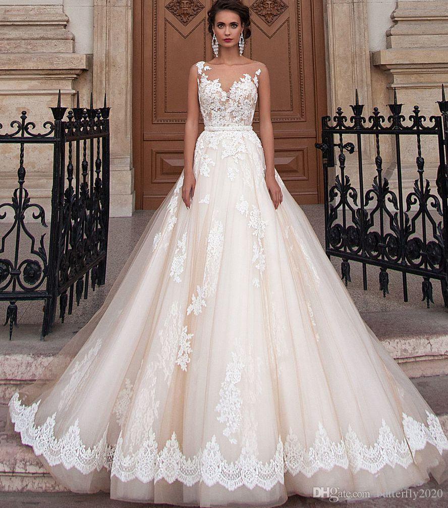 Discount champagne tulle lace wedding dresses plus size appliques discount champagne tulle lace wedding dresses plus size appliques sheer illusion bodice country wedding dress modest bridal gowns custom color traditional ombrellifo Choice Image