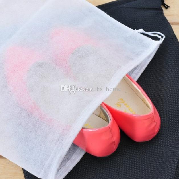 Paquet de chaussures de voyage à usage unique sac de rangement de chaussures en tissu non tissé épaississement de haute qualité peut stocker une variété de chaussures.