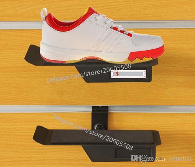 Art und Weise Schuhgeschäft neue Art Sneaker beiläufige Schuhe Ausstellungsstandgestellmetallschuhe auf der Wandanzeige, die Halterregal / zeigt