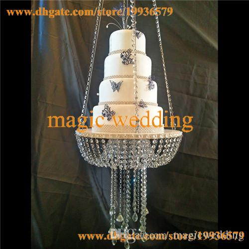 making a wedding cake stand glass chandelier style drape suspended swing cake 17051