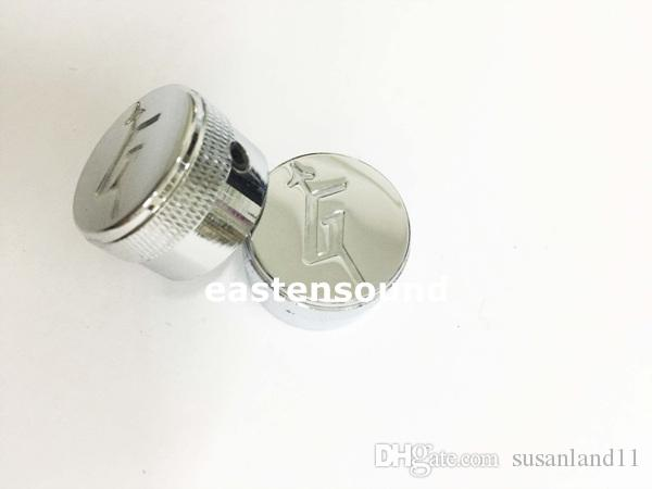 A Set of chrome metal Control Knobs for Electric Guitar
