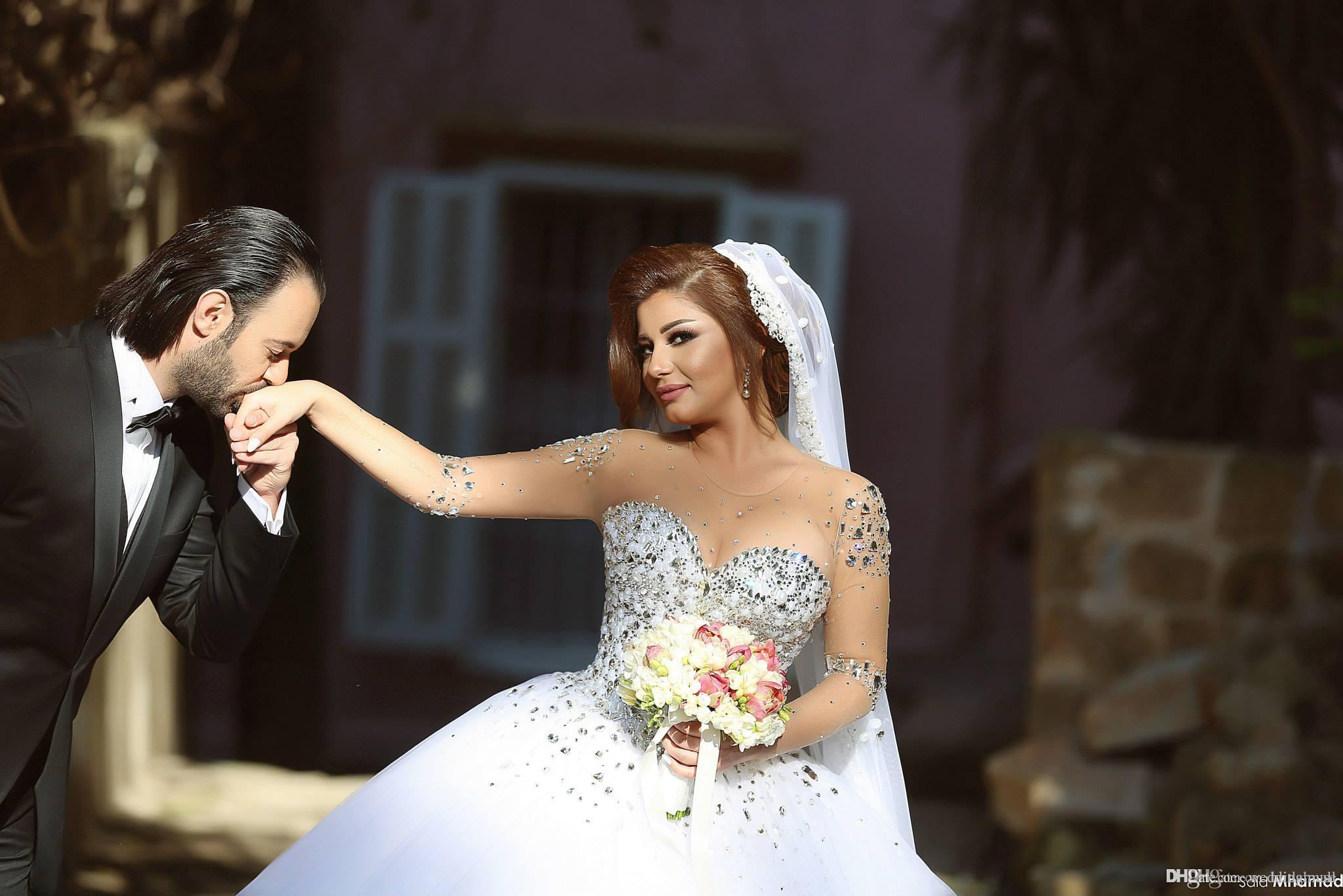 무거운 크리스탈 구슬로 만드는 긴 소매를 아프리카 결혼 예복 투명한 목 튤 라인 신부 드레스티 웨딩 드레스 드레스 novia