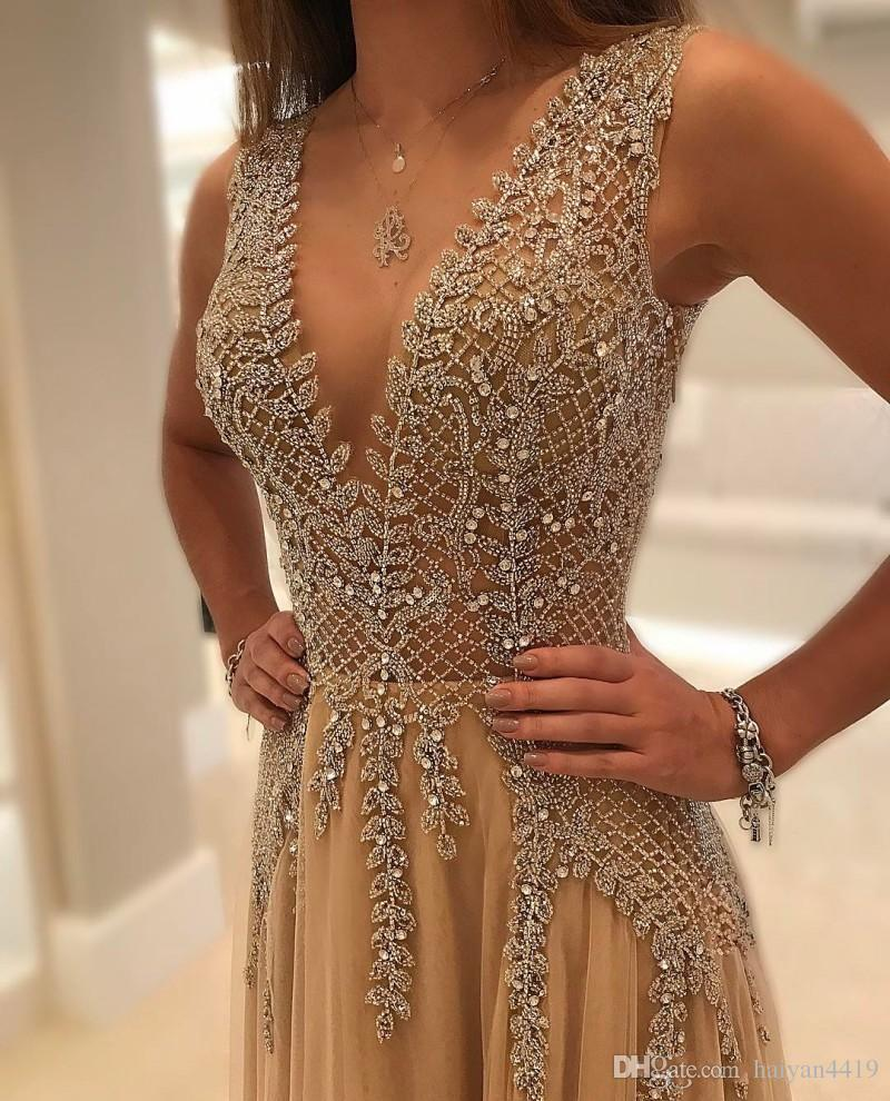 2020 Plus Size Bling Champagne Prom Dresses Crystal Beaded Lated Spalato Illusione Deep V Collo in tulle Open Back Party Abito Abito da sera formale Abiti da sera
