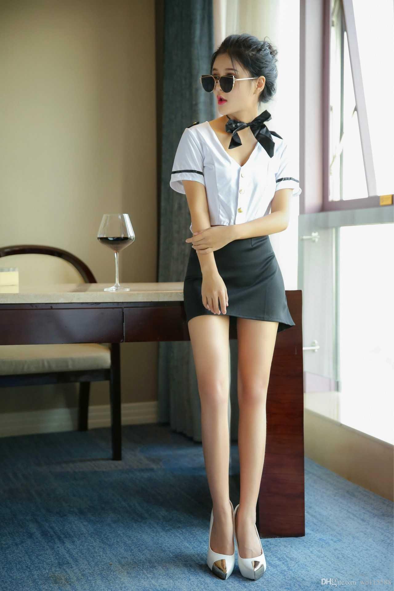 Le nuove uniformi sexy dell'hostess delle natiche sexy della biancheria di trasporto libero uniformano la camicia da notte sexy della tentazione OL di usura professionale delle donne sotto sexy