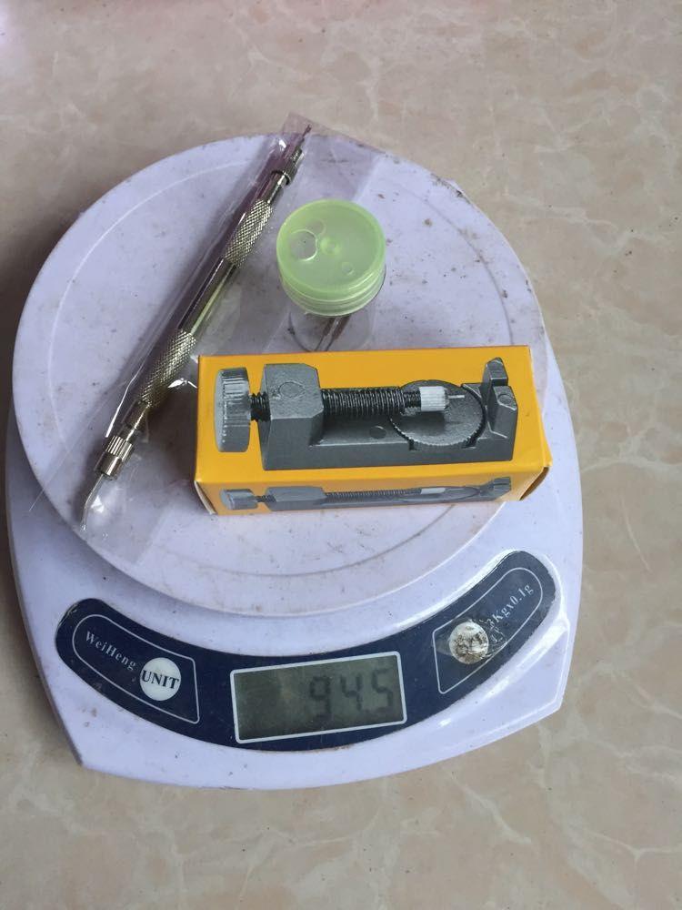 Strumento di riparazione bracciale con cinturino in metallo e levetta di ancoraggio
