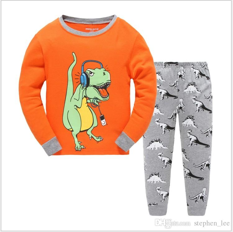 2017 niños lindos dinosaurios de manga larga camiseta + pantalones conjunto pijamas ocasionales de los niños establece ropa de los niños trajes niño otoño invierno casa desgaste