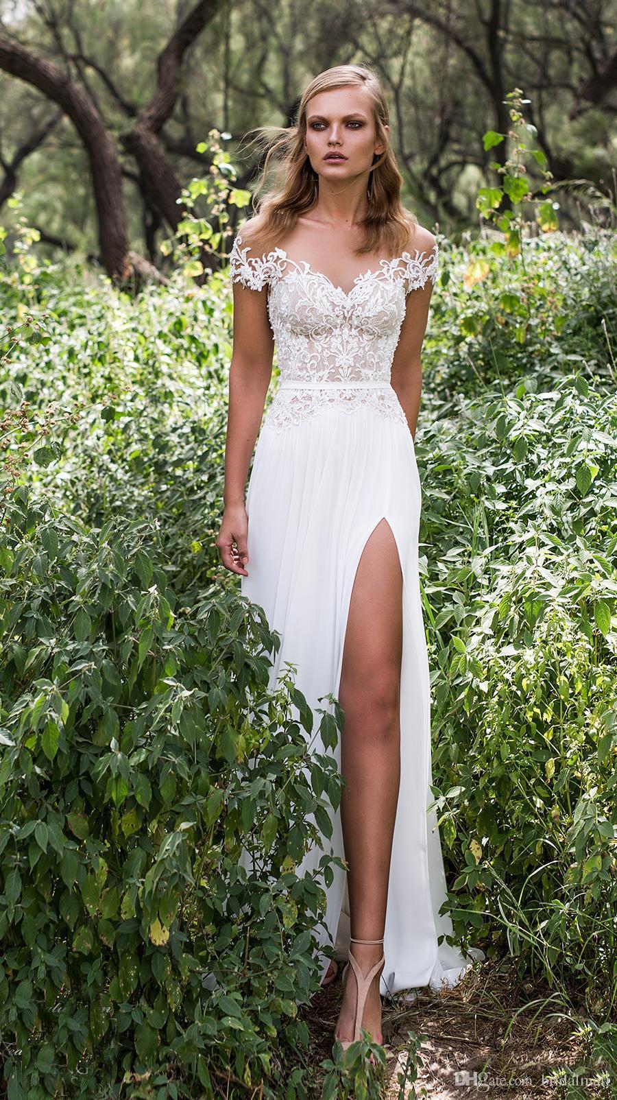 Bohemia Modest Chiffon A Line Vestidos de novia Sheer Neck Cap Mangas Boho Beach Vestido de novia Sexy High Split País Vestidos de novia Vestidos