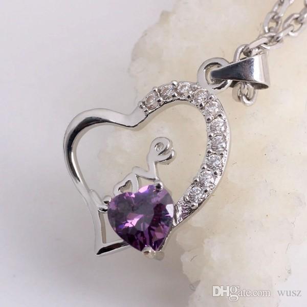 Nueva joyería de fantasía real 925 en forma de corazón collar de plata esterlina femenina coreana moda cristal letra amor colgante