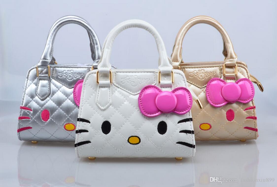 New Designers Mini Cute Bag Children Hello Kitty Bowknot Handbag Kids Tote  Girls Shoulder Bag Mini Bag Wholesale Online Girls Bags Side Purse For  Girls From ... b79230531cae3