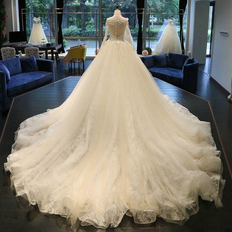 2018 mais novo Jewel Neck A linha de vestidos de casamento Catedral Trem apliques de contas manga comprida Botão-se Voltar nupcial do casamento Vestidos