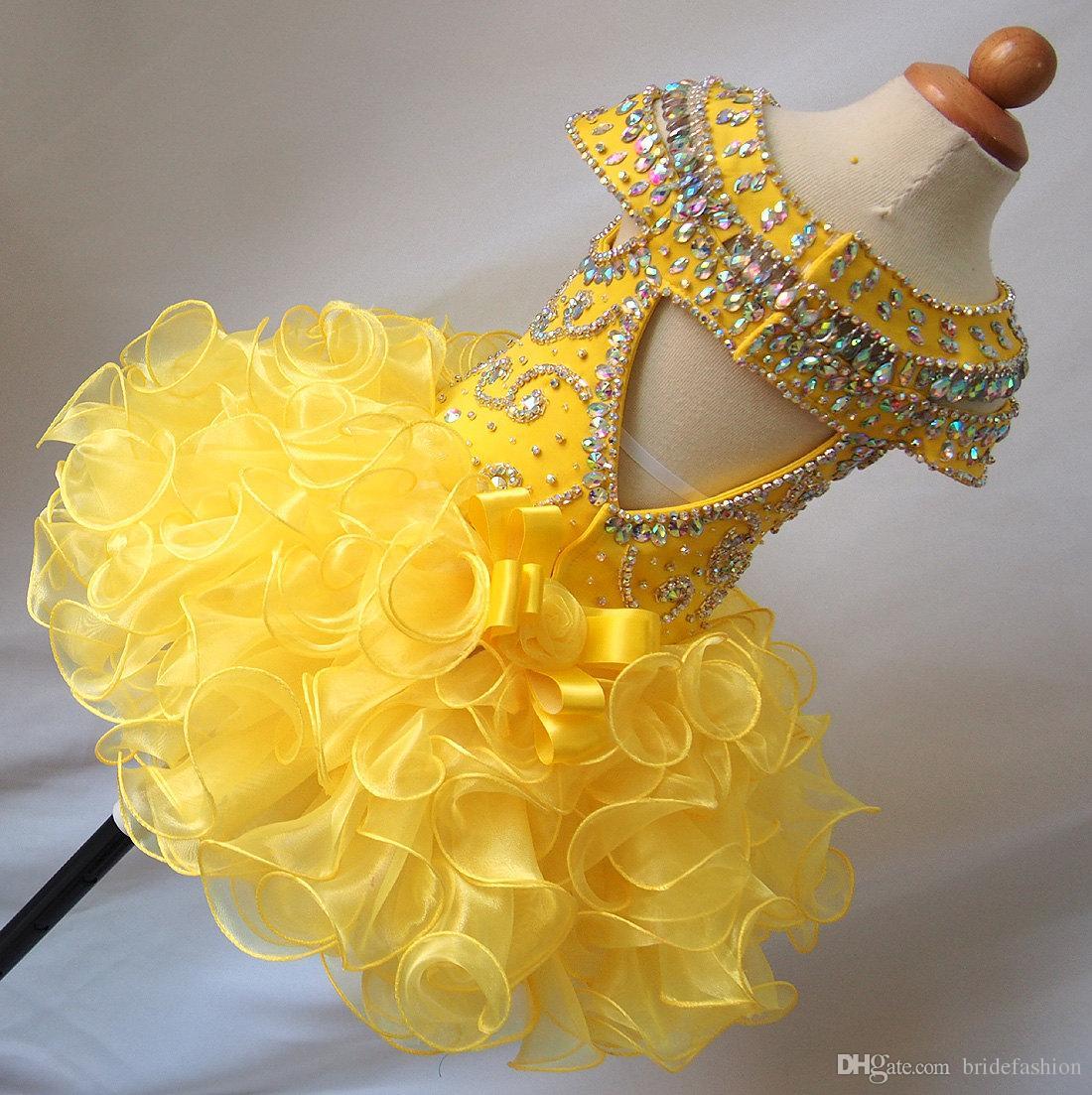 Organza giallo backless bordatura scoop scoop abito maniche corte mini ragazze cupcake Little flower Pageant Party Pageant Abiti Junior Gowns