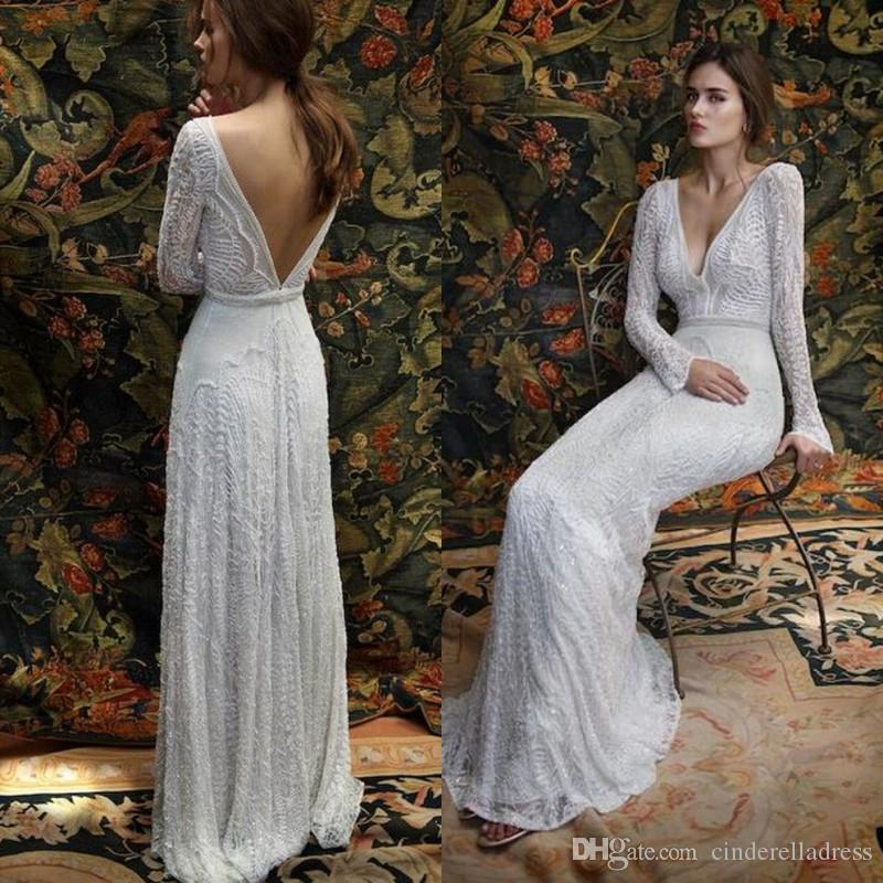 Discount 2017 New Romantic Bohemian Lace Backless Wedding Dresses V Neck Long Sleeves Garden Beach Bridal Gowns Fairy Sweep Train 1970s Hippie Boho