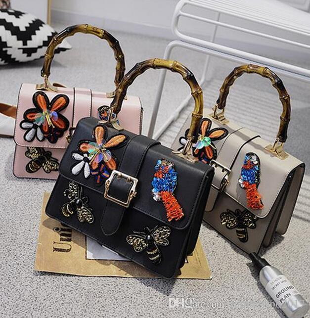 Factory wholesale brand fashion handbag bag heavy embroidered retro folk style embroidery bamboo bag cute little bee Sequin woman bag