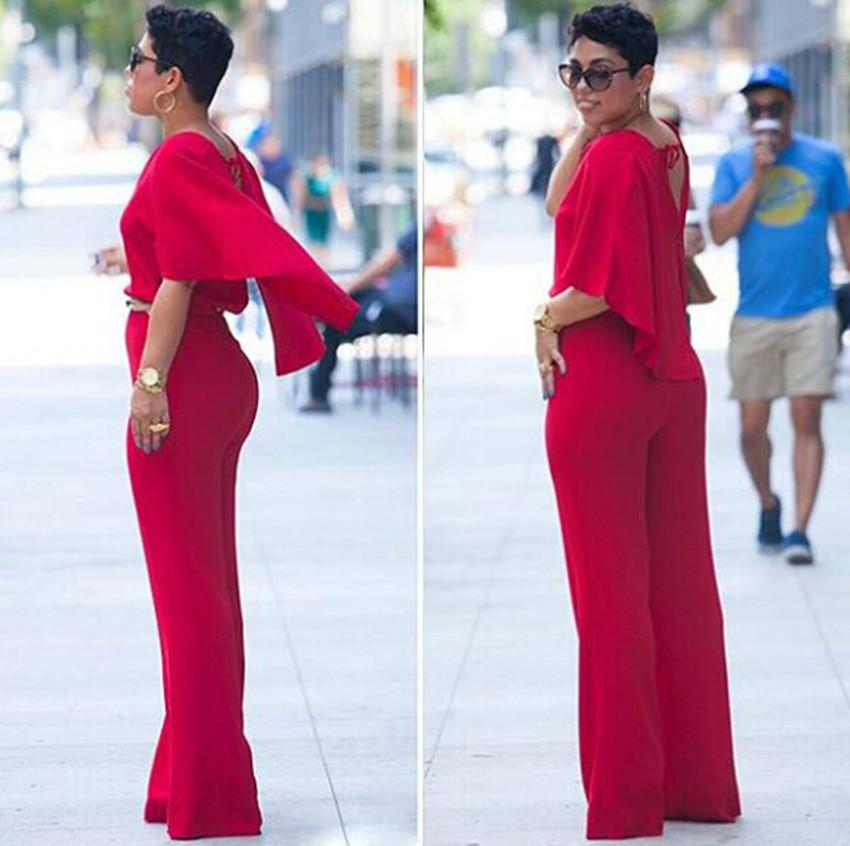 af8d05acbe2 2019 Wholesale Sexy Deep V Neck Backless Red Jumpsuit Women New Plus Size  Summer Style Rompers Womens Jumpsuit Loose Long Pants Rompers Overall From  Keviny