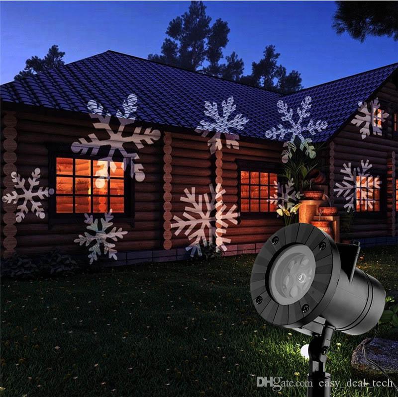 Natal Do Laser Do Floco De Neve Projetor Ao Ar Livre Lâmpada LED À Prova D 'Água Luzes de Discoteca Casa Jardim Luz Estrela Decoração Interior 12 Tipos Q0033