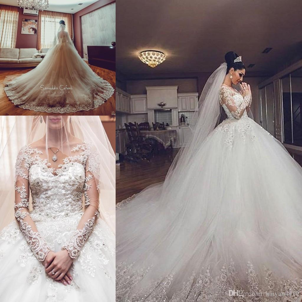 ed788e063e 2018 New Sexy Bling Arabic Long Sleeves Ball Gown Wedding Dresses Illusion  Neck Lace Appliques Crystal Beaded Plus Size Formal Bridal Gowns White Ball  Gown ...