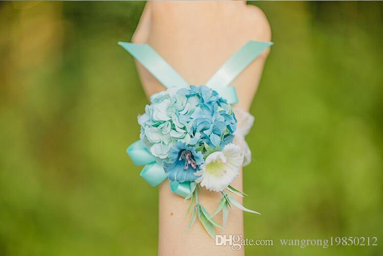 The bride bridegroom blue pink flowers corsages brooches beach wedding bouquets the bride holding flowers bridesmaids bouquets wrist flowers
