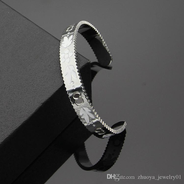 Titanium steel jewelry wholesale C-shaped open gear edge white drop oil pattern bracelet G letter bracelet ladies bracelet