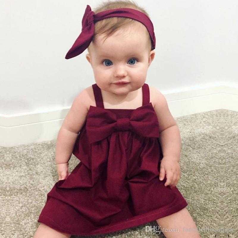 04924aedfda4f 2019 Ins Hot 2017 New Arrival Summer Cute Baby Girl Burgundy Big Bowknot  Suspender Dress Birthday Party Dress From Fancyfrillboutique, $39.38    DHgate.Com