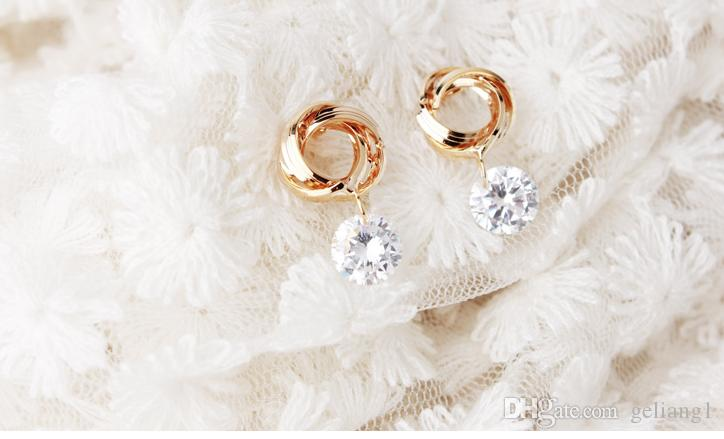 Серьги-гвоздики с двумя кольцами, 925 пробы. Выбор прекрасной дамы