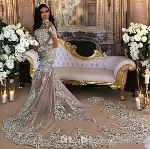 Luxury Sparkly 2017 Designer Abito da sposa Sexy Sheer Bling bordato in pizzo Applique collo alto Illusion manica lunga sirena cappella abiti da sposa