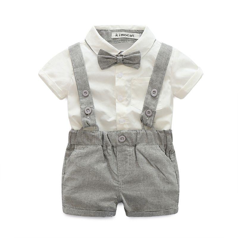 2017 niños del bebé 3 pedazos fija el traje del caballero niños del muchacho 100% algodón falda blanca + mamelucos + corbata de moño niños conjuntos de ropa envío gratis es