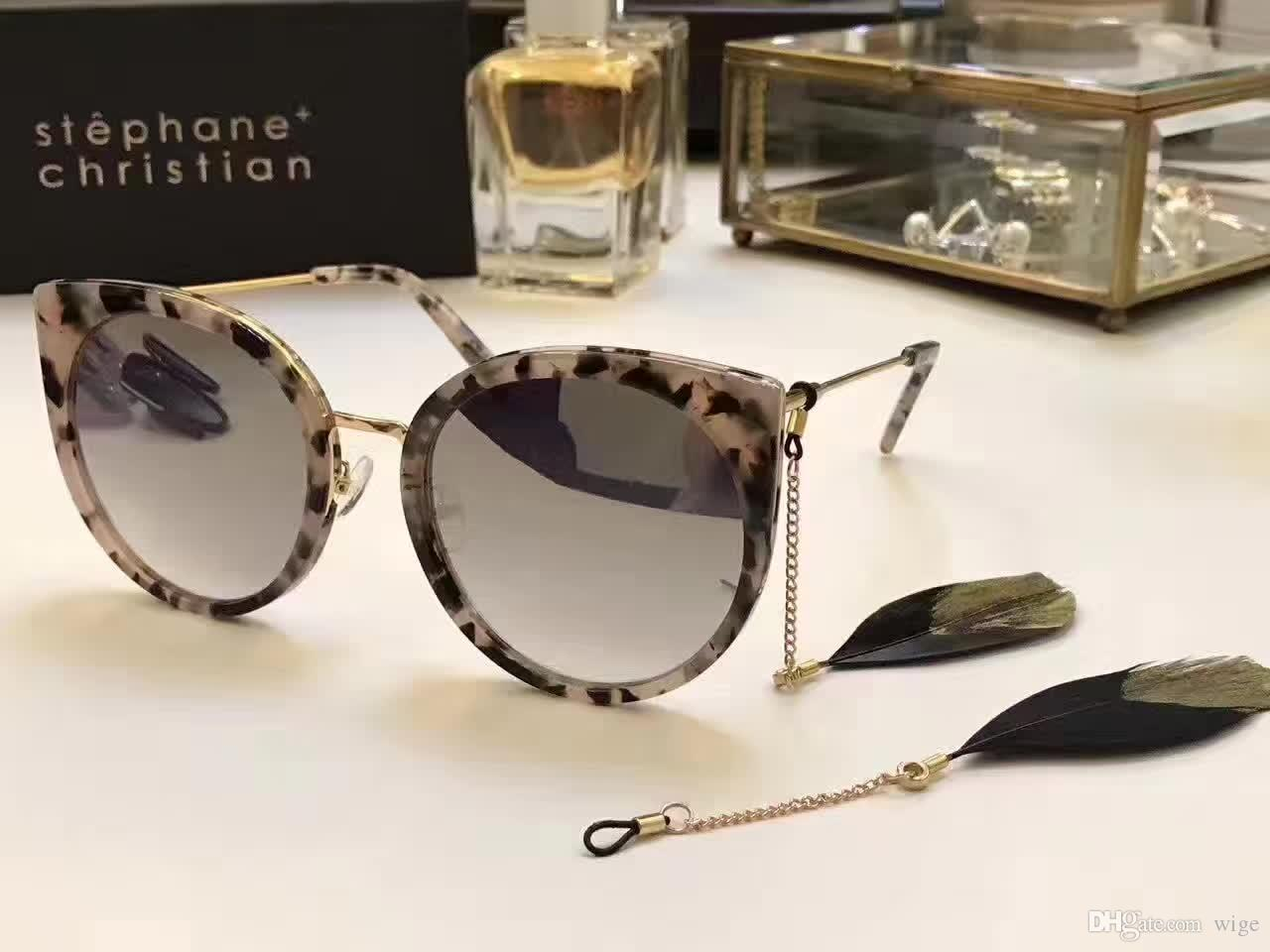 6e62a9acd5e4 Stephane Christian Cat Eye Sunglasses With Feather Designer Brand Sunglasses  Eyeglasses New With Box Wiley X Sunglasses Mirror Sunglasses From Wige