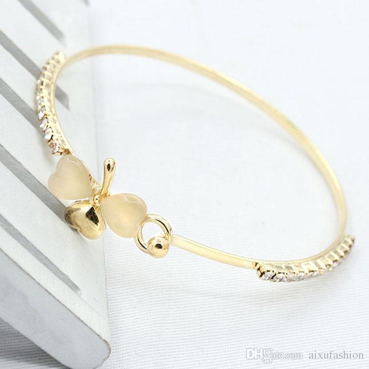 Venta al por mayor de las mujeres pulseras brazalete de joyería Exquisito de lujo pequeño perfume melocotón pulseras de corazón de oro plata trébol opal completo diamante pulsera