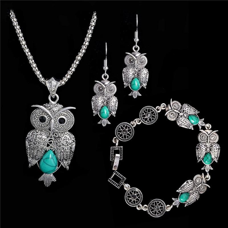53953c5f4276 Kostenloser Versand Schmuck Set tibetische Silber Halskette Eule Anhänger  Charm Armband baumeln Ohrringe Set Türkis Schmuck 2 Farben