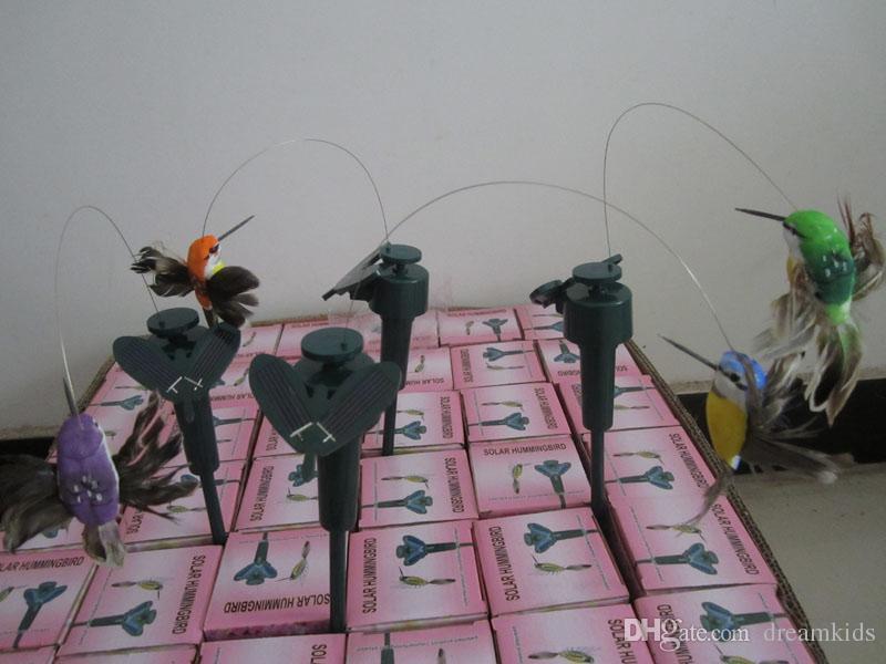 fliegende flatternde Kolibris, fliegender Vogel des Vogels mit Federflügel, Gartenvögel spielen DHL FEDEX VERSCHIFFEN