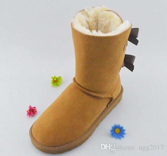 Snow boots cowhide factory direct cowhide belt bowknot warm winter in the cylinder non-slip wear-resistant women