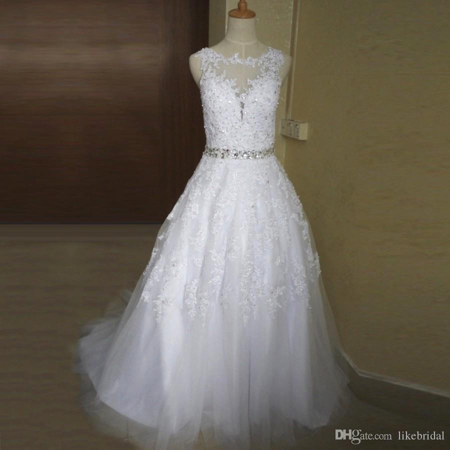 2019 Dernières Robes De Mariée Scoop Neck Sheer Cou Robe De Bal Dentelle Appliqued Robes De Mariée Perlées Taille Robes De Noivas Sexy Dos Nu