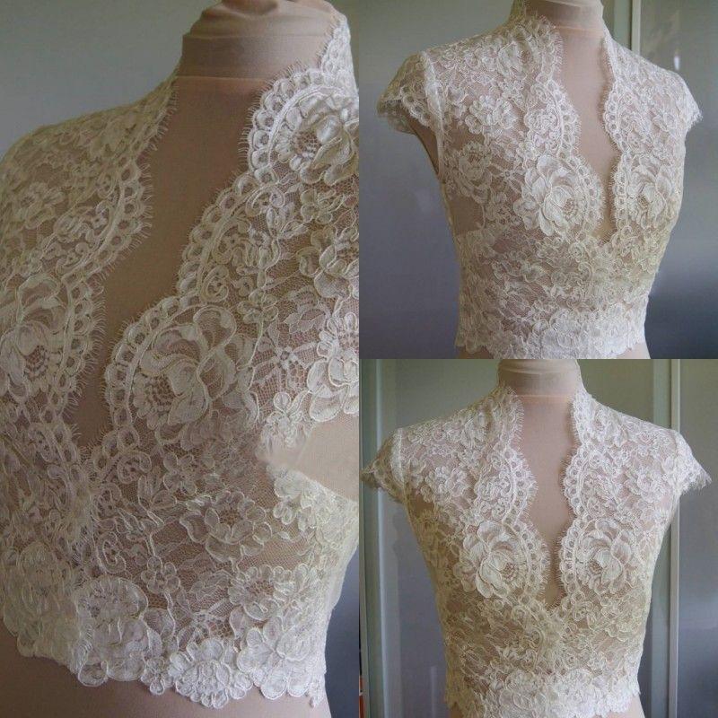 90025ee3b22be 2019 Cheap Ivory Bridal Wraps Short Sleeves Bridal Coat Lace Jackets  Wedding Capes Wraps Bolero Jacket Wedding Dress Wraps Plus Size From  Manweisi