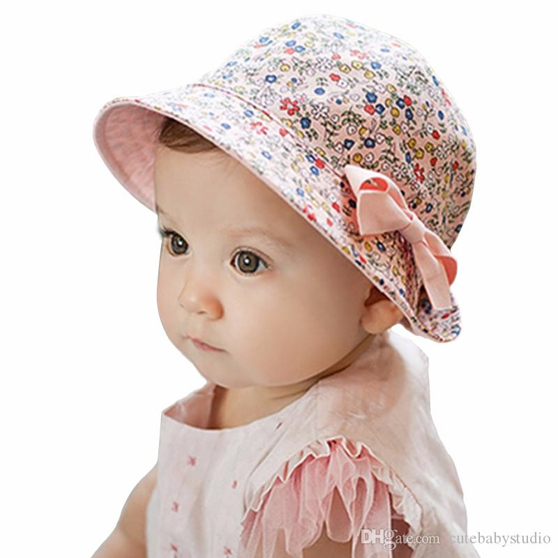 2017 Fashion Baby Girl Hats Summer Two Sided Cap Hat Infant Kids Children  Floral Bowknot Sun Hat Bucket Gorro Bonnet UK 2019 From Cutebabystudio 2856f033fa0
