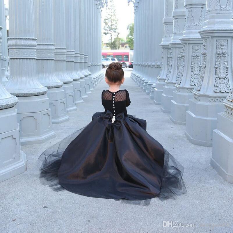 Vestiti nuovissimi della ragazza di fiore nero con le ragazze delle bambine a manica lunga Vestito da comunione del partito del vestito da cerimonia nuziale del vestito da cerimonia nuziale nozze