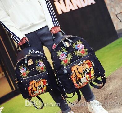 Korean goods JTXS genuine shoulder bag female Korean version of the backpack tide cloth personality tiger head embroidery Oxford spinning ba