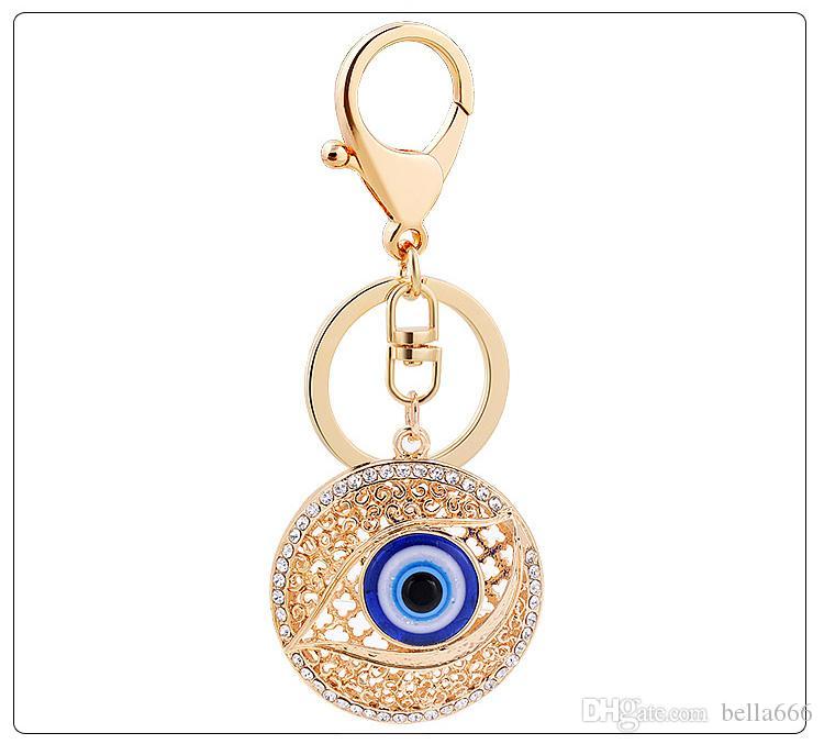 f1a2bb1cc9b0 2019 Creative Women Rhinestone Crystal Big Eye Round Lady Waterdrop Metal Key  Ring Car Bag Ornaments Key Chains Garment Accessories Jewelry From  Bella666