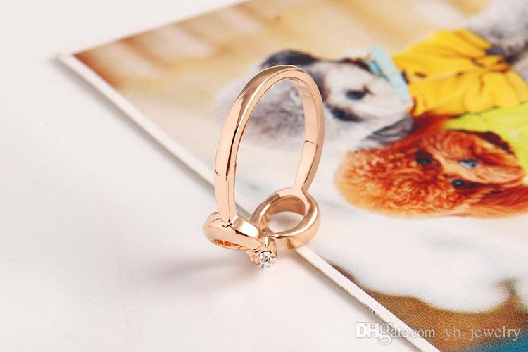 Mode à l'envers forme 8 anneau zircon cristal métal zircon anneau tempérament contracté anneau bijoux femelle prix usine livraison gratuite