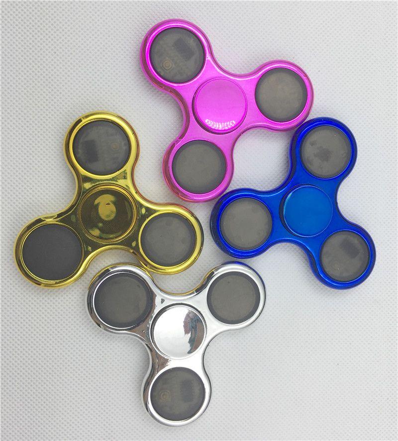 DHL LED Light Up Fidget Spinner con 6 LED Beads 3 Patterns CE RoHs Scatola di latta metallica Sostituibile Batteria Tri-spinner EDS LED Spinners Giocattoli P-ZJ