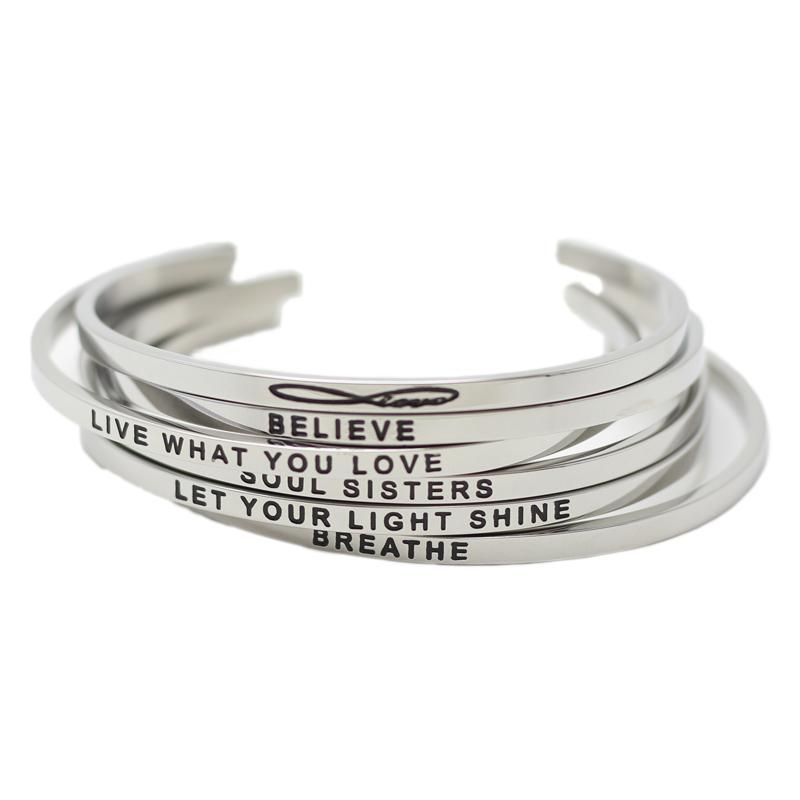 the ck jewelry stamped store in feminist pin as bullish f hand bracelet silver cuff